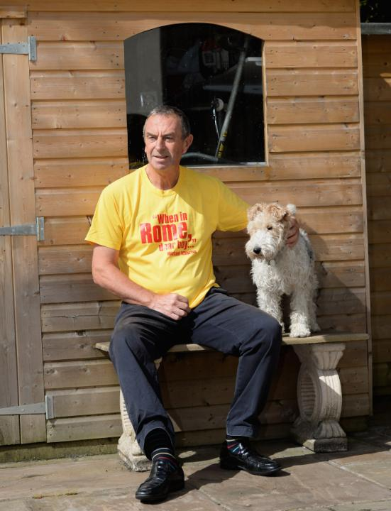 ALDERLEY EDGE, ENGLAND - APRIL 23:  Former England cricketer and television commentator David 'Bumble' Lloyd with his dog Tags at his home on April 23, 2013 in Alderley Edge, England.  (Photo by Gareth Copley/Getty Images)