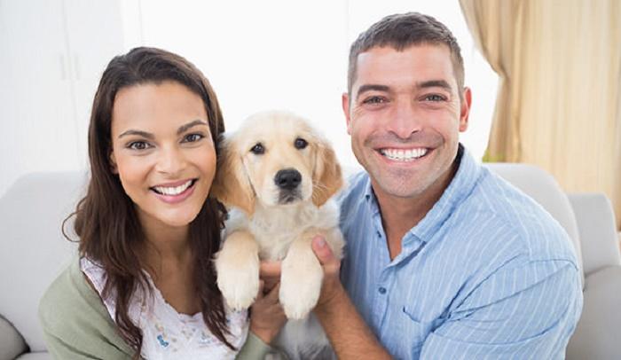 bigstock-Portrait-of-happy-couple-holdi-85023749