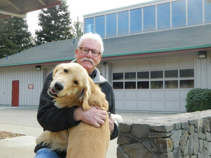 man_holding_dog-1024x768